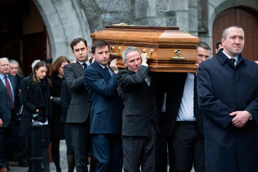 The remains of former secretary general at the Department of Foreign Affairs Dermot Gallagher are brought from his funeral mass in the Holy Trinity Church Ratoath. Photo:Mark Condren