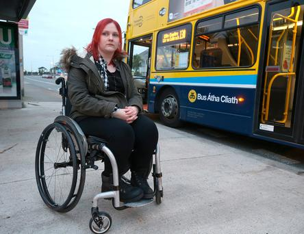 Satires Smith (25) at her local bus stop in Clontarf, she has great difficultly in finding wheelchair friendly transport. Photo: Damien Eagers