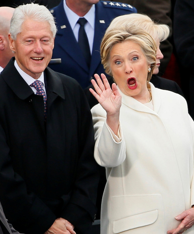 Former president Bill Clinton and defeated Democratic candidate Hillary Clinton salute well-wishers following the inauguration ceremony. Photo: Getty