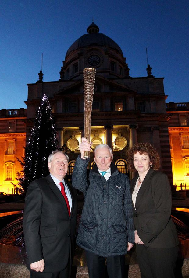 Pat Hickey holding aloft the Olympic torch in 2012