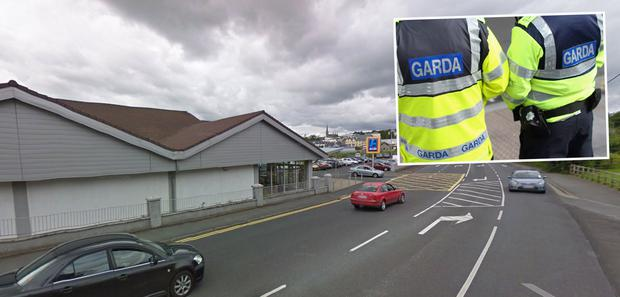 The attack happened after the elderly man did his shopping in Aldi, Letterkenny, Co Donegal. Inset: Gardai