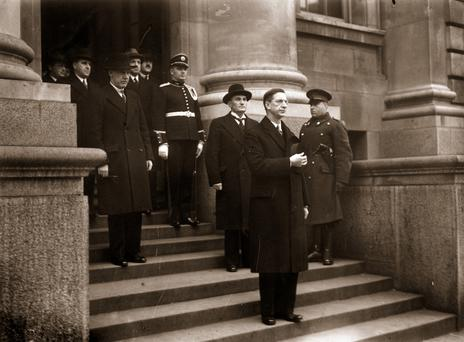 Taoiseach Eamon de Valera takes the salute on the steps of the government buildings in Dublin, after finalising the new Irish constitution. (Photo by Keystone/Getty Images)