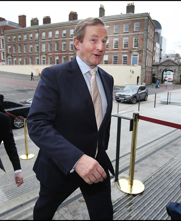 Taoiseach Enda Kenny arriving at the Corporate Tax Conference at Dublin Castle yesterday. Photo: Steve Humphreys