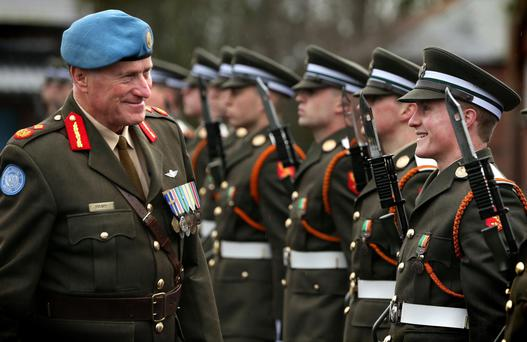Major General Michael Beary, who is in charge of the UN mission in Lebanon, with his son, Cadet Howard Beary (right), of the 93rd Cadet Class, during a parade in the Curragh Camp. Photo: Gerry Mooney