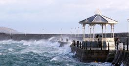 Waves crash against the pier in Dun Laoghaire, Co Dublin, during Storm Doris. Photo: Stephen Collins