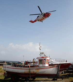 A Coast Guard helicopter returns to Blacksod, Co Mayo Photo: Brian Lawless/PA Wire