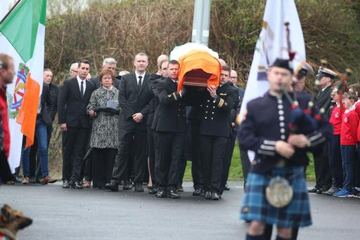 Mourners attend the funeral of Captain Mark Duffy Photo: Mark Condren