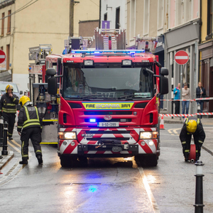 Early morning horror: Firefighters clearing up at the scene of the fire yesterday in the centre of Sligo town Photo: James Connolly