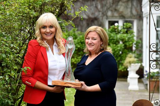 RTÉ's Miriam O'Callaghan presents Independent News and Media Group Business Editor Dearbhail McDonald with the Mary Cremmins award at the Women in Media conference in Co Kerry. Photo: Domnick Walsh