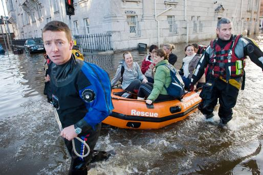 Rescue workers take doctors and nurses to Cork's Mercy Hospital during flooding in the city in 2009. Photo: Daragh McSweeney
