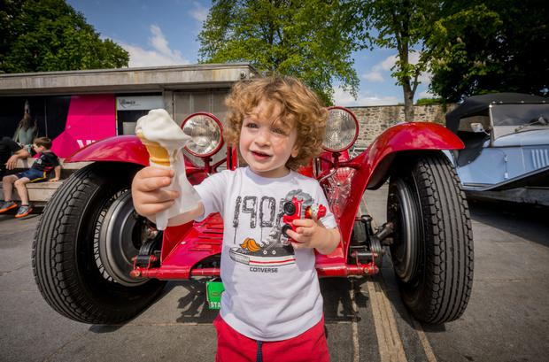 Zuka Luarsabrishvili (3) from Dublin enjoys an ice-cream at a vintage car show in Kilkenny. Picture: Dylan Vaughan