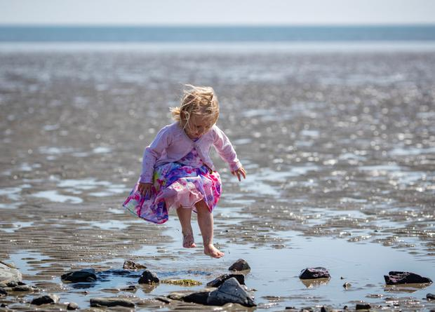 Anna McArdle (2) from Dundalk makes a splash at Blackrock beach in Co Louth Picture: Arthur Carron