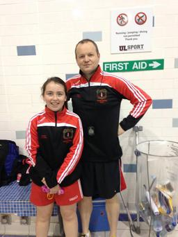 Clodagh Hayes (13) and her Dolphin swimming club coach Mick McCormack.