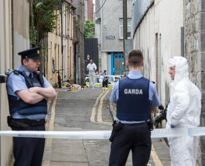 Forensic officers examine the scene of the altercation between a number of men in Roches Row in Limerick city. Photo: Liam Burke/Press 22