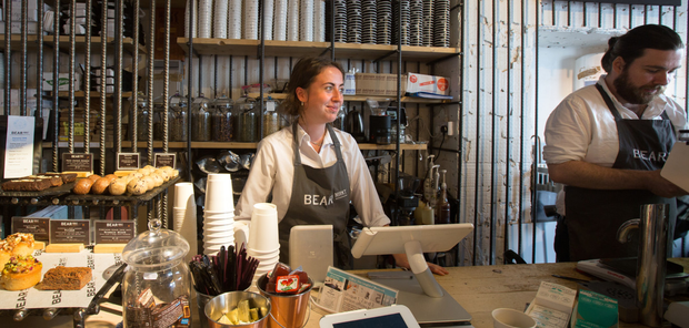 Bean to cup: Rebecca McNamara serves customers in The Bear Market Coffee Shop in Blackrock. Photo: INM