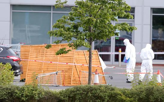 Forensic experts examine the scene of the shooting in Bangor, Co Down. Picture: Presseye