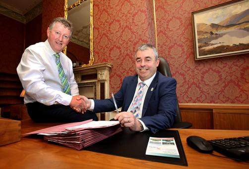 Seán Canney, left, outgoing minister for the OPW and Flood Relief, congratulates his successor Kevin 'Boxer' Moran, who has big plans for the office. Photo: Tom Burke