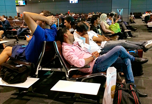 Passengers whose flights were cancelled wait in Hamad International Airport in Doha, Qatar. Photo: AP