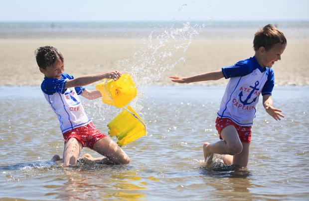 Brothers Adomas (8) and Tomas (6) Simenas at Dollymount Strand. Picture: Collins