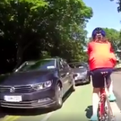Screenshot from video shows parked cars blocking the cyclist lane in Phoenix Park