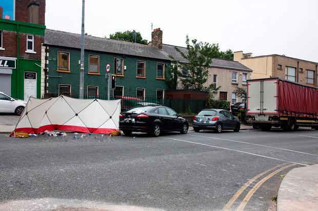 Gardai at the scene of the road traffic incident at Emmet Road. Photo: Arthur Carron