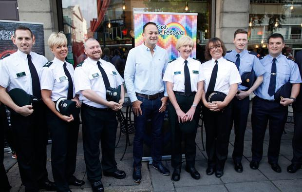 Taoiseach Leo Varadkar meets members of the PSNI and Garda representative of the gay community as he arrives for a Gay Pride breakfast meeting at the Northern Whig bar in Belfast. Picture: PA
