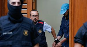 Catalan officers detain a suspect in Ripoll during a search linked to the terror attacks in Barcelona and the resort of Cambrils. Picture: AFP