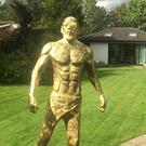 Eamon Heneghan created the life-size gold statue of Conor McGregor