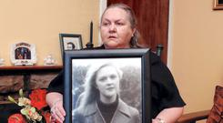 Josephine Pender with a picture of daughter Fiona Pender