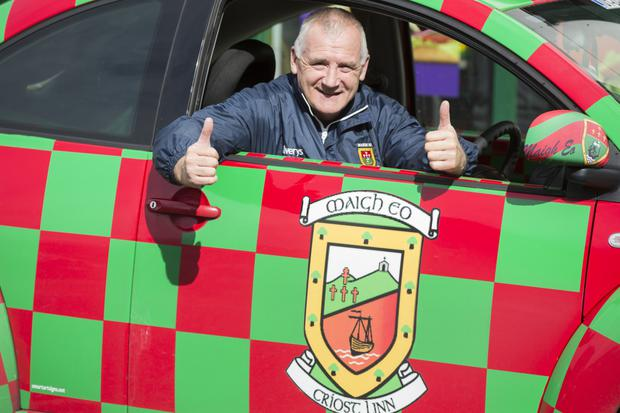 Tom Deering in his car customised with Mayo colours in Castlebar. Photo: Mark Condren