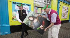Left: Don McGreevy and Martin Keane with a subtly altered painting of the Mona Lisa in Westport. Photo: Mark Condren