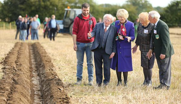 Sean Monaghan from Longford has his work inspected by President Michael D Higgins and his wife Sabina, along with Anna May McHugh and NPA chairman Denis Kohane. Picture: Gerry Mooney