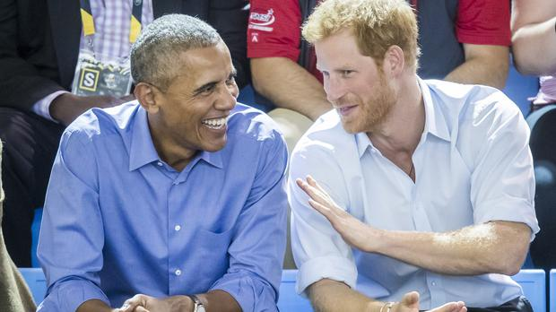 Barack Obama was reportedly overheard asking Harry about his relationship with Meghan Markle (Danny Lawson/PA)