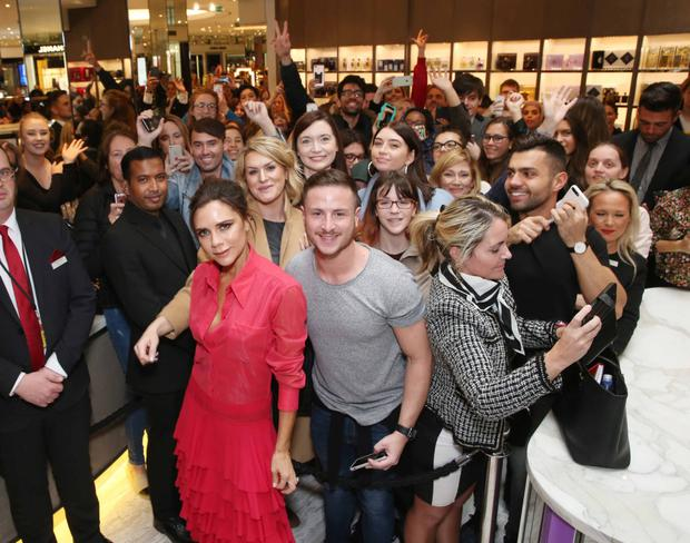 Victoria Beckham with fans yesterday in Brown Thomas yesterday. Photo: Leon Farrell