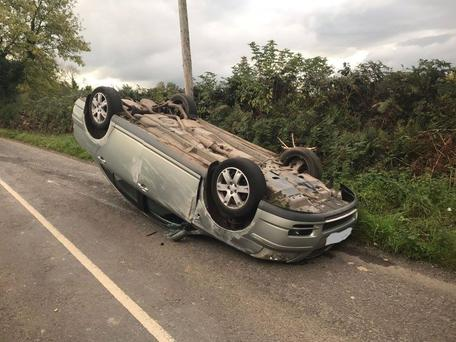 The shocking image of the car after it flipped over on a Cork road Photo: Garda Facebook