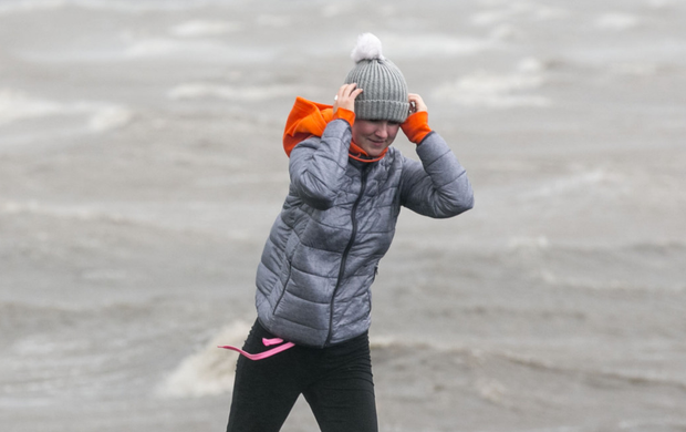 A woman holds on to her hat as Ophelia hits Tralee in Co Kerry. Photo: Mark Condren