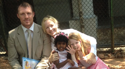 HAPPY FAMILY: Eric Miller with his wife Jenny and daughters Hannah and Nisha, who was adopted in March 2016