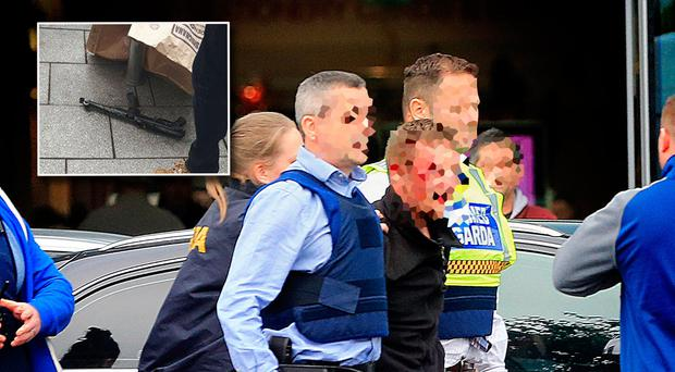 Moment man is arrested at CityWest Photo: Gerry Mooney (Inset: The firearm that was recovered nearby)