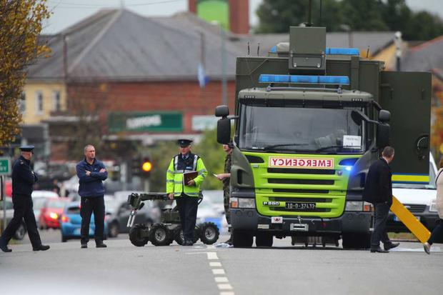 The Defence Forces EOD unit and rover pictured at Finglas Garda Station this afternoon. Photo: Colin O'Riordan