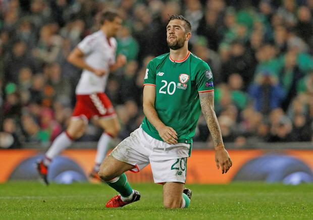 Shane Duffy looks dejected after Denmark's second goal. Picture: Reuters