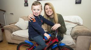 Tadhg Fearon with his mother Alison, who is urging people to get involved in the Santa Cycle fundraiser for the Straight Ahead charity. Photo: Doug O'Connor