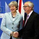 Theresa May and Jean-Claude Juncker in Brussels Photo: AP