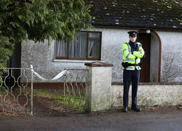 The crime groups are believed to have targeted vulnerable bachelor Joseph Waters in Kildangan, Co Offaly. (Pictured: Gardai at the home of Mr Waters)