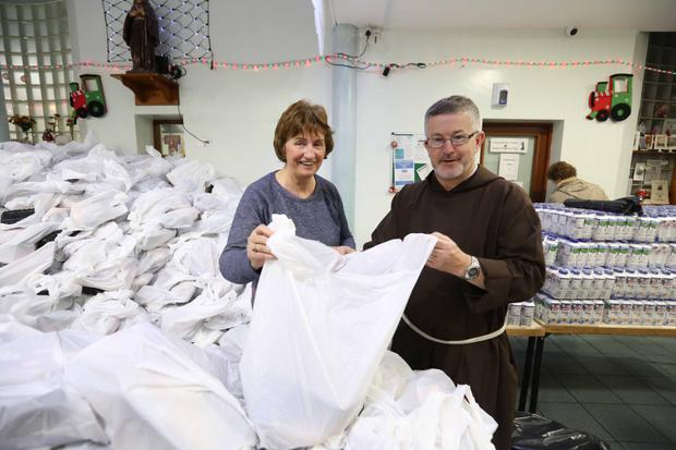 Marian Smyth and Brother Sean Donohoe prepare Christmas packages for the needy at the Capuchin Day Centre in Dublin. Photo: Sam Boal/Rollingnews.ie