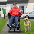 Frustrated: Padraic Moran pictured with his special assistance dog Gail in Bray, Co Wicklow PHOTO: JUSTIN FARRELLY