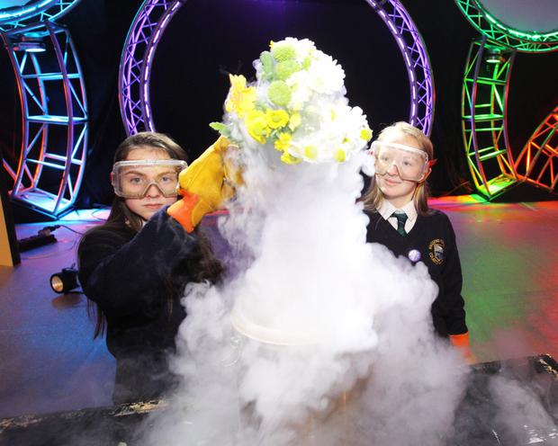 Clodagh Clarke and Abbie Cassidy, first-year students from Ringsend College, play with liquid nitrogen at the launch of the competition. Photo: Colm Mahady