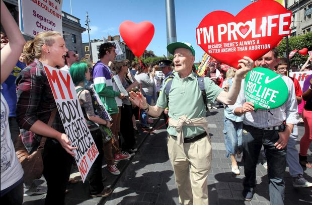Pro life marchers pass Pro Choice protestors on O'Connell Street (Stock Image)
