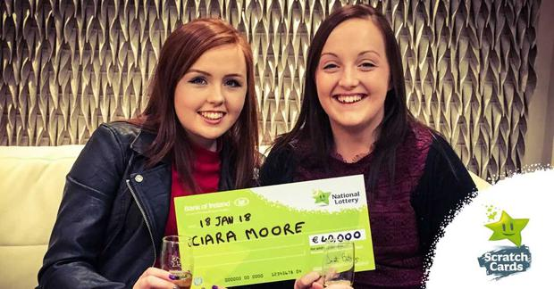 Ciara Moore (Right) and her sister Áine who gifted her the winning €3 scratch card, celebrate in the National Lottery Winners' Room after she scooped the €40,000 prize.
