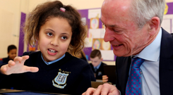 Salma Abbas, pupil at St Audoen's National School, talks to Minister Richard Bruton at the launch of the Action Plan for Education 2018