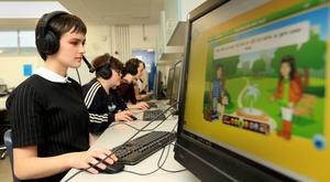 Newpark Comprehensive School Blackrock student Ruby O'Leary Murray takes part in language learning activities in the interactive language learning room at the school